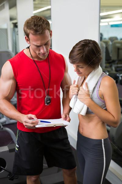Knap personal trainer cliënt gymnasium gelukkig Stockfoto © wavebreak_media