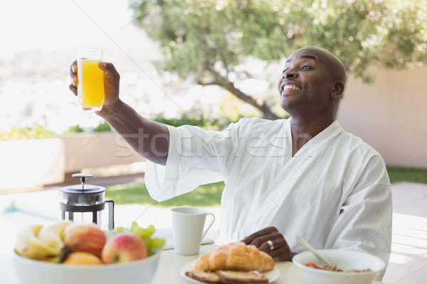 Jóképű férfi fürdőköpeny reggeli kívül napos idő ház Stock fotó © wavebreak_media