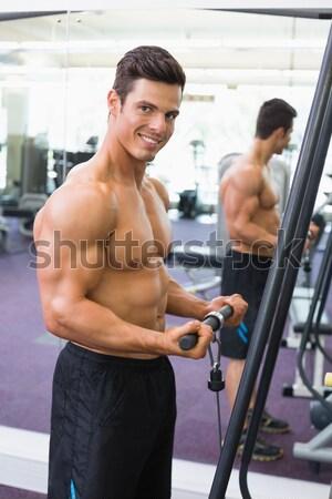 A torso nudo muscolare uomo bilanciere determinato Foto d'archivio © wavebreak_media