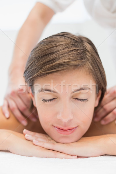 Stock photo: Attractive woman receiving shoulder massage at spa center