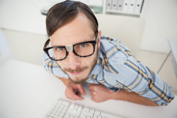 Stock photo: Nerdy businessman working on computer