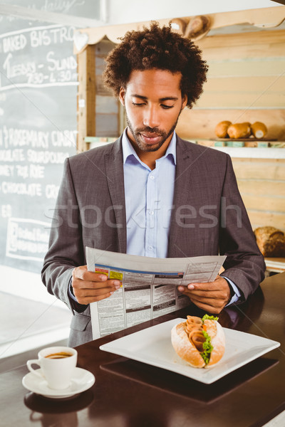 Businessman reading newspaper while having lunch Stock photo © wavebreak_media