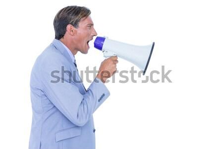 Young man shouting through megaphone Stock photo © wavebreak_media
