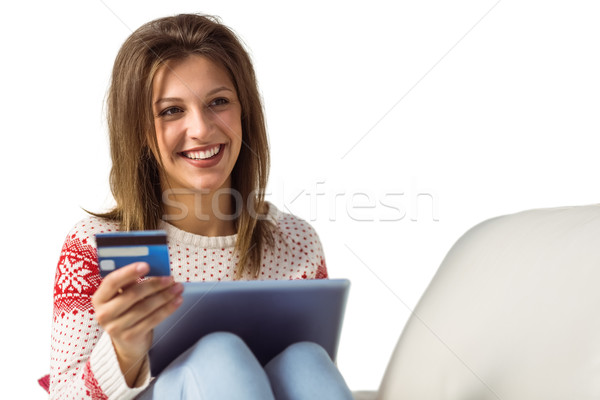 Woman doing online shopping with laptop and credit card Stock photo © wavebreak_media