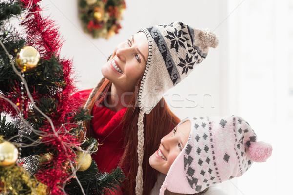 Anya lánygyermek karácsonyfa otthon nappali ház Stock fotó © wavebreak_media