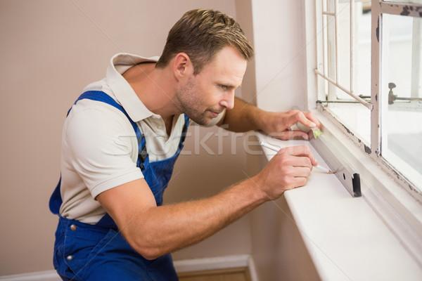 Pracownik budowlany duch poziom domu człowiek Zdjęcia stock © wavebreak_media