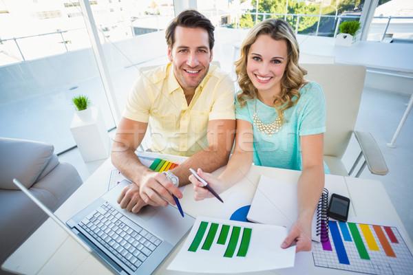 Sonriendo creativa equipo de negocios reunión oficina ordenador Foto stock © wavebreak_media