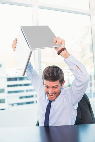Angry businessman throwing his laptop Stock photo © wavebreak_media