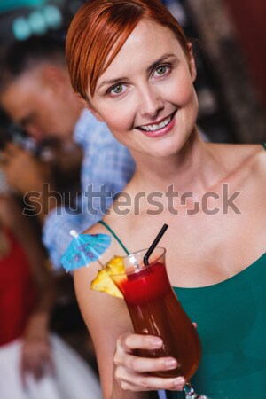 Pretty redhead drinking glass of champagne on couch Stock photo © wavebreak_media