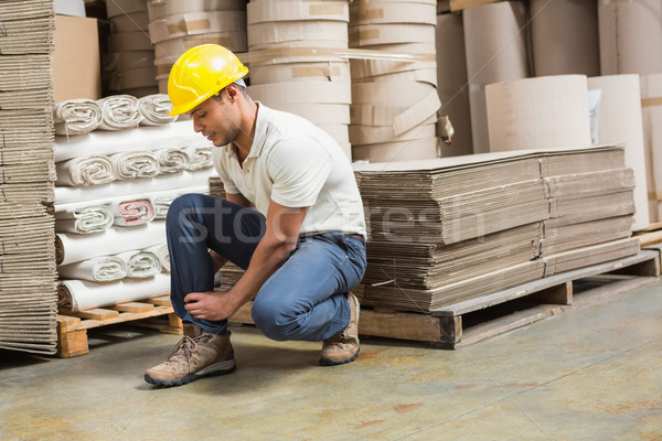 Worker with sprained ankle on the floor Stock photo © wavebreak_media