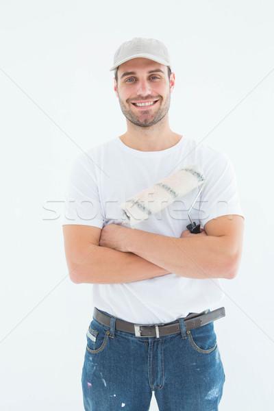 Feliz homem pintar em pé retrato Foto stock © wavebreak_media
