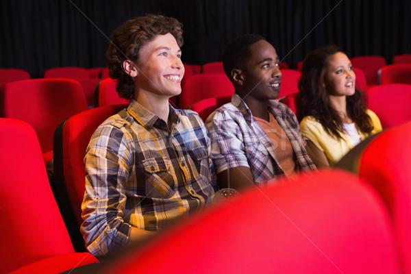 Jonge vrienden kijken film bioscoop man Stockfoto © wavebreak_media
