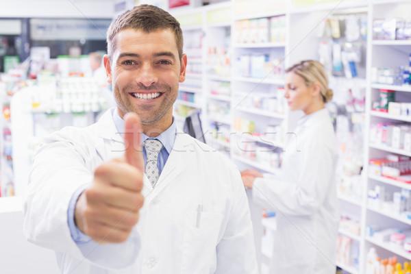 Feliz farmacêutico polegar farmácia mulher Foto stock © wavebreak_media