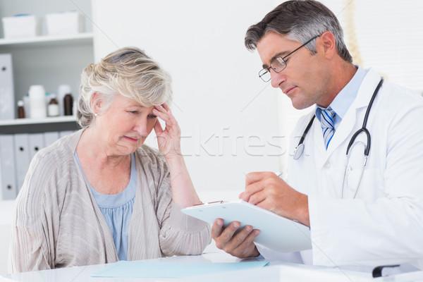 Doctor explaining prescription to senior patient Stock photo © wavebreak_media