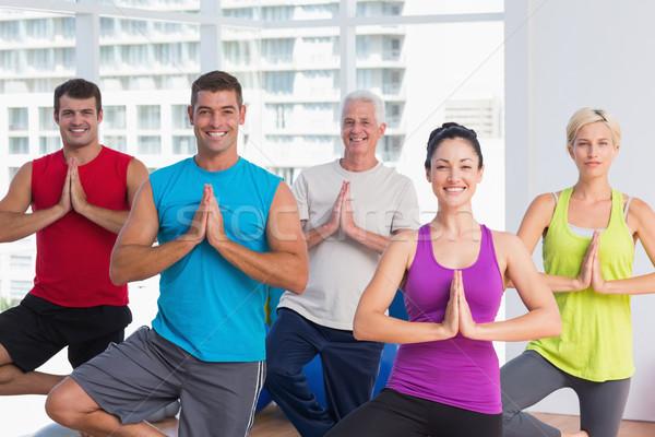 People practicing tree pose in fitness studio Stock photo © wavebreak_media
