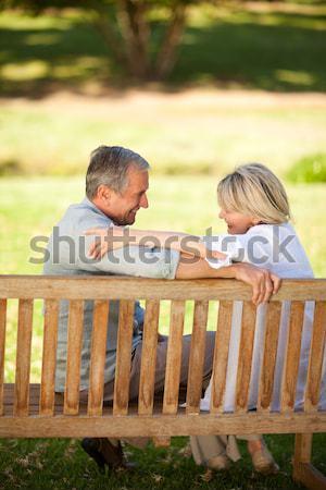 Solitário mulher sessão casal parque Foto stock © wavebreak_media