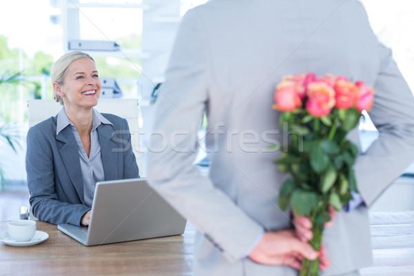 бизнесмен сокрытие цветы за назад коллега Сток-фото © wavebreak_media
