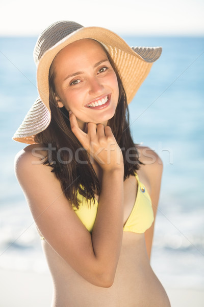 Brunette relaxing with a straw hat smiling at camera Stock photo © wavebreak_media