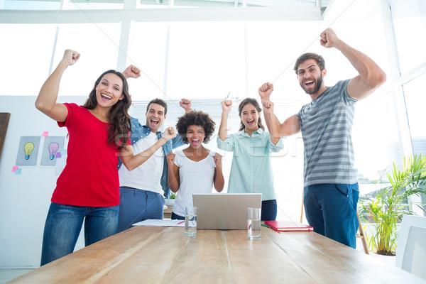 Feliz equipo de negocios aire oficina negocios ordenador Foto stock © wavebreak_media