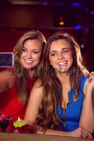 Pretty friends drinking cocktails together Stock photo © wavebreak_media