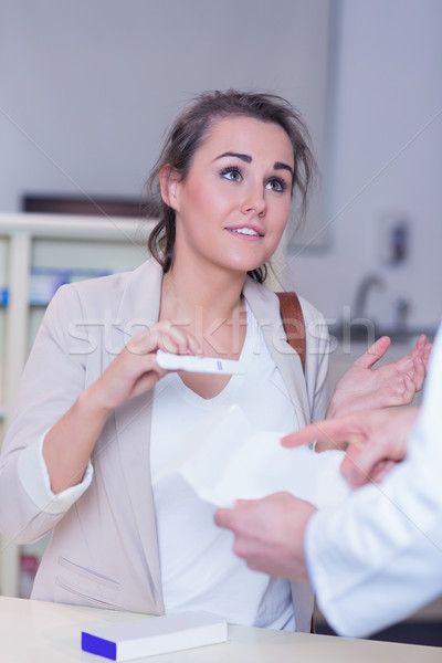 Shocked woman holding pregnancy test Stock photo © wavebreak_media