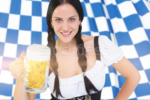 Composite image of pretty oktoberfest girl holding beer tankard Stock photo © wavebreak_media