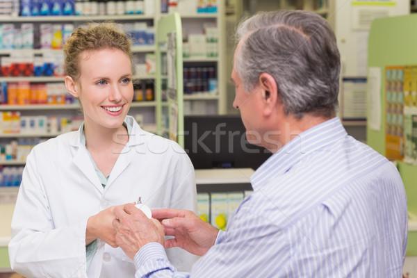 Pharmacist explaining something to a customer Stock photo © wavebreak_media
