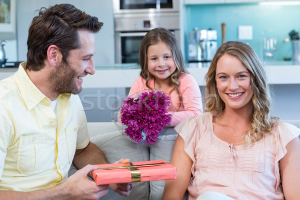 Father and daughter surprising mother with gift Stock photo © wavebreak_media