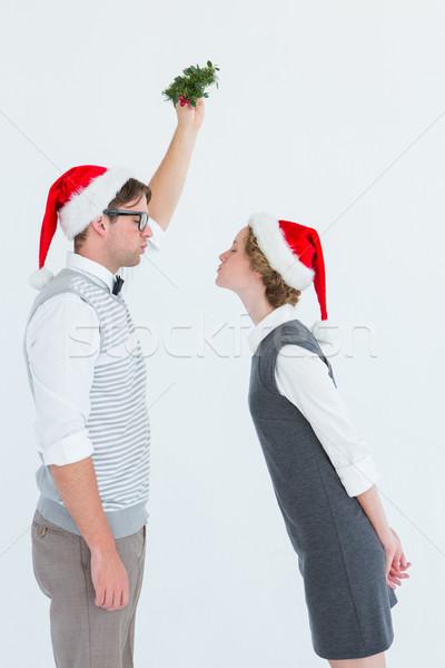 Beijando visco branco moda casal Foto stock © wavebreak_media