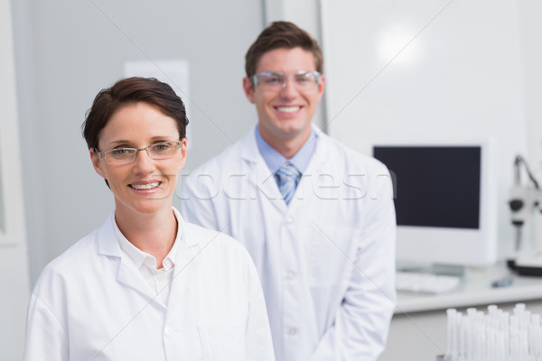 Scientists smiling and looking at camera Stock photo © wavebreak_media
