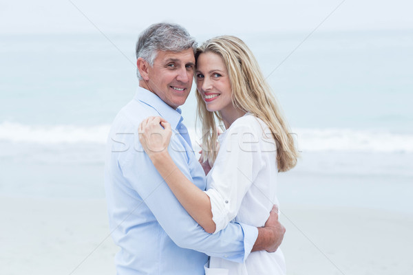 Happy couple hugging each other by the sea Stock photo © wavebreak_media