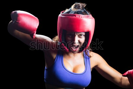 Composite image of portrait of pretty boxer with fighting stance Stock photo © wavebreak_media