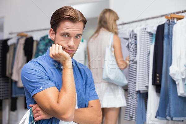 Aburrido hombre mano barbilla ropa tienda Foto stock © wavebreak_media
