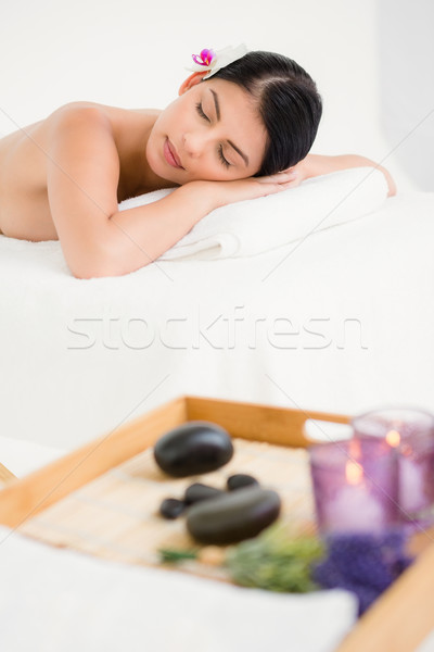 Pretty woman lying on the massage table Stock photo © wavebreak_media