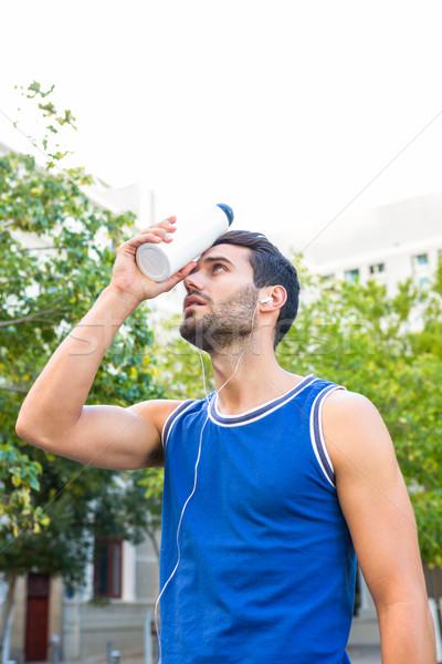 красивый спортсмена охлаждение лоб бутылку город Сток-фото © wavebreak_media