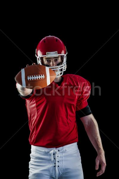 Stockfoto: Portret · amerikaanse · voetballer · tonen · voetbal