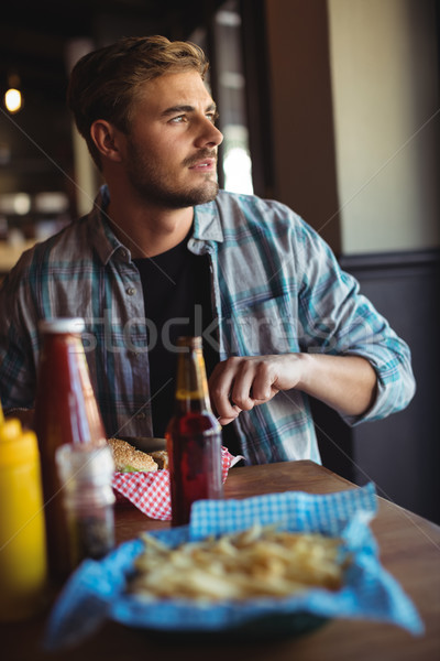 Man having burger together Stock photo © wavebreak_media