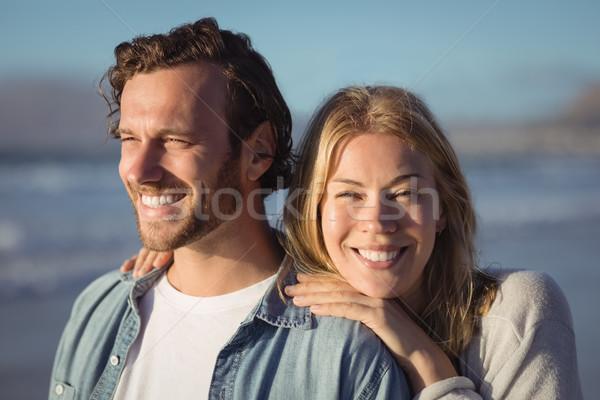 Mosolygó nő fiúbarát áll tengerpart napos idő nő Stock fotó © wavebreak_media