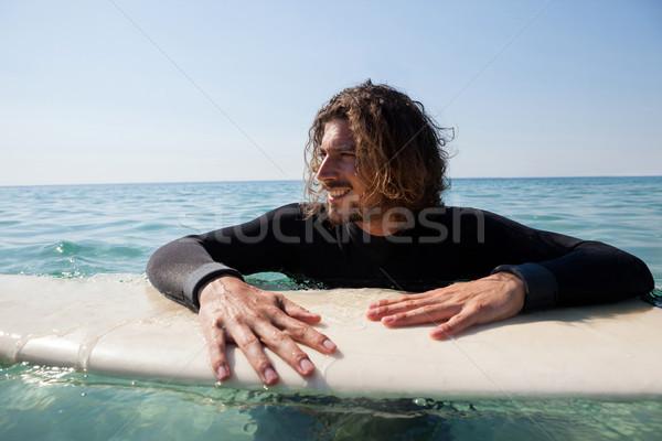 Surfer tavola da surf mare sorridere spiaggia Foto d'archivio © wavebreak_media