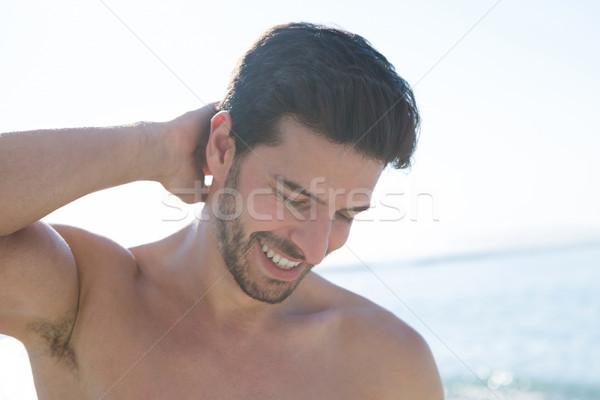 Uśmiechnięty przystojny półnagi człowiek plaży Zdjęcia stock © wavebreak_media