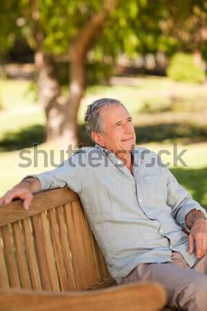 Senior man leaning on wooden fence Stock photo © wavebreak_media