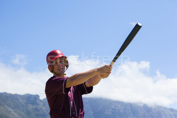 Baseball playing hitting with bat against mountain Stock photo © wavebreak_media