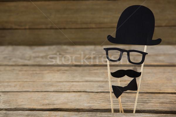 Anthropomorphic face on wooden table Stock photo © wavebreak_media