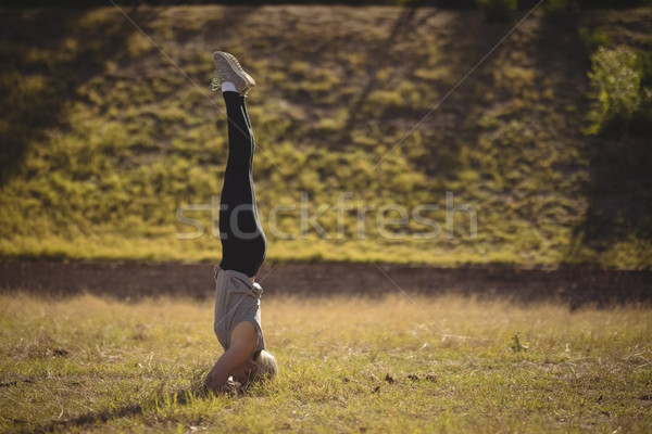 Woman performing headstand during obstacle course Stock photo © wavebreak_media