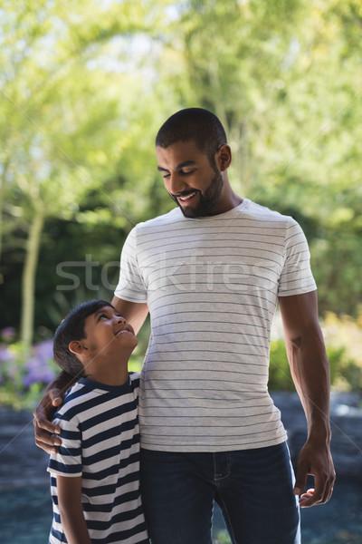 улыбаясь человека сын Постоянный крыльцо молодым человеком Сток-фото © wavebreak_media