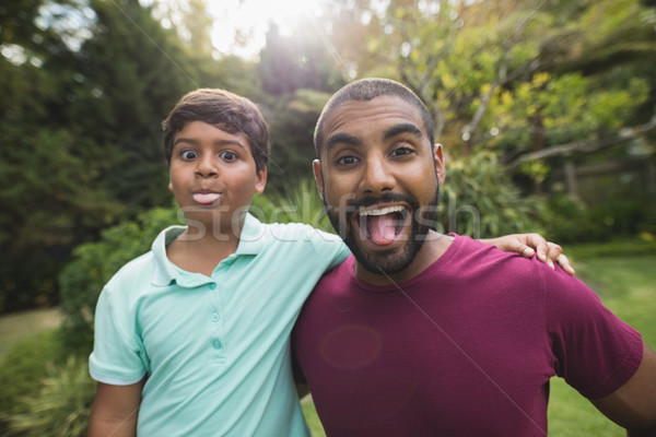 Mischievous father and son enjoying at park Stock photo © wavebreak_media