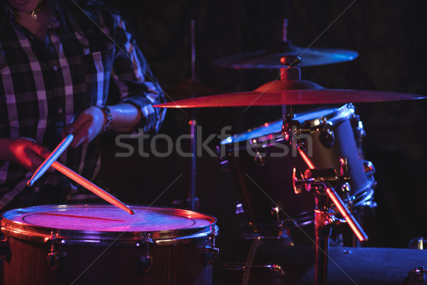 Female drummer playing drum set in nightclub Stock photo © wavebreak_media