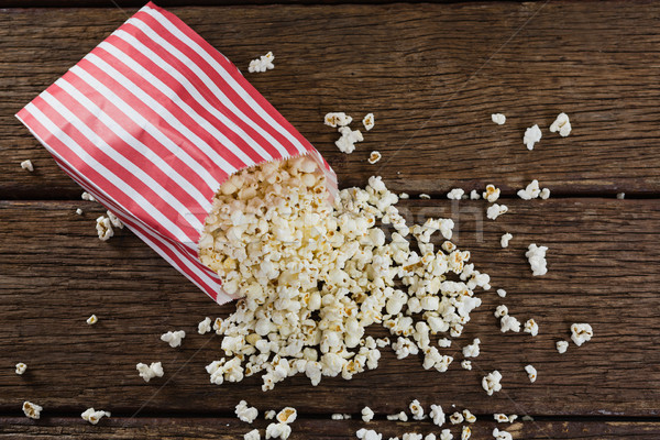 Scattered popcorn on wooden table Stock photo © wavebreak_media