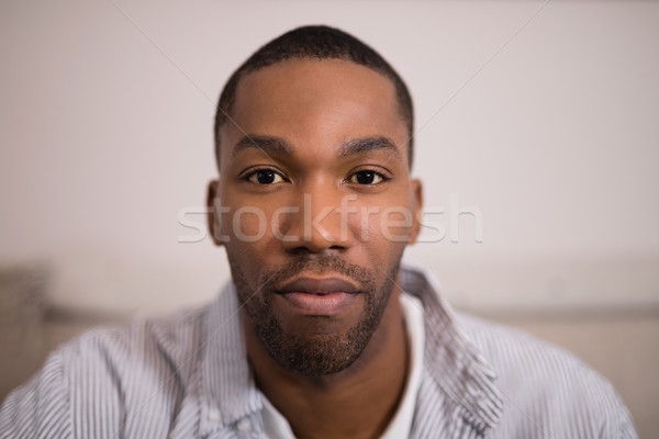 Portrait of confident young man at home Stock photo © wavebreak_media