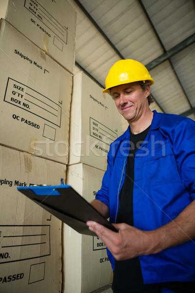 Worker maintaining record on clipboard Stock photo © wavebreak_media